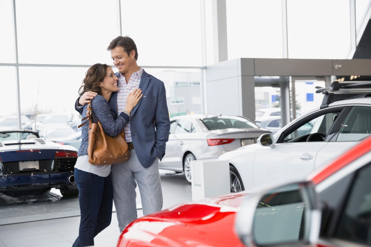 Couple-hugging-in-car-dealership-xlarge